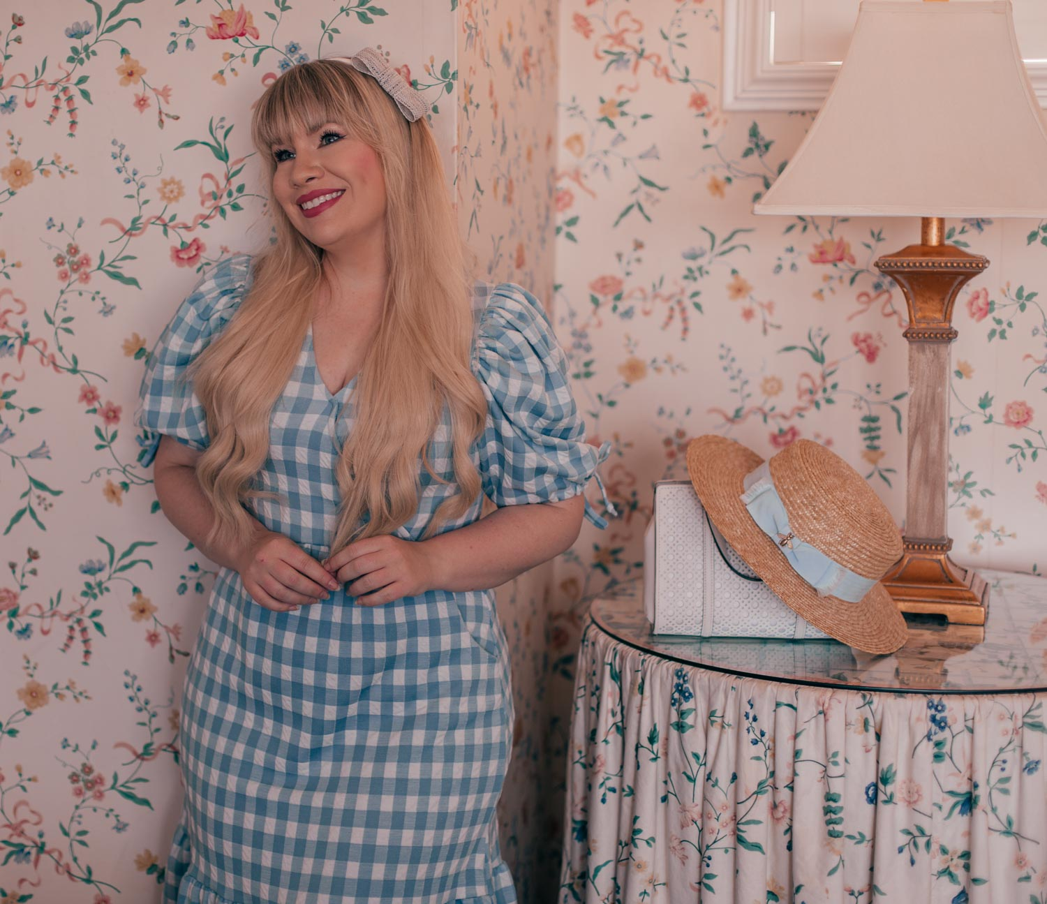 Feminine fashion blogger Elizabeth Hugen of Lizzie in Lace shares 3 Feminine Summer Hair Accessories to Wear Now including this gorgeous bow headband! it looks perfect with this blue gingham summer dress