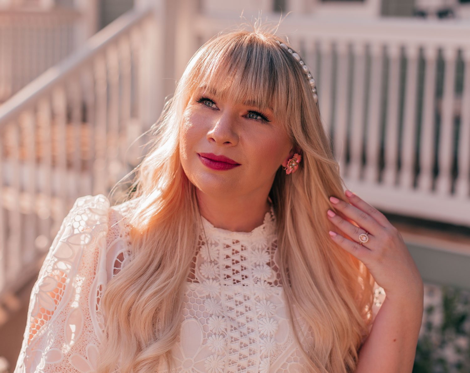 Feminine Fashion Blogger Elizabeth Hugen of Lizzie in Lace shares a feminine floral summer outfit idea including a white lace top, pink floral chicwish skirt and vintage floral earrings