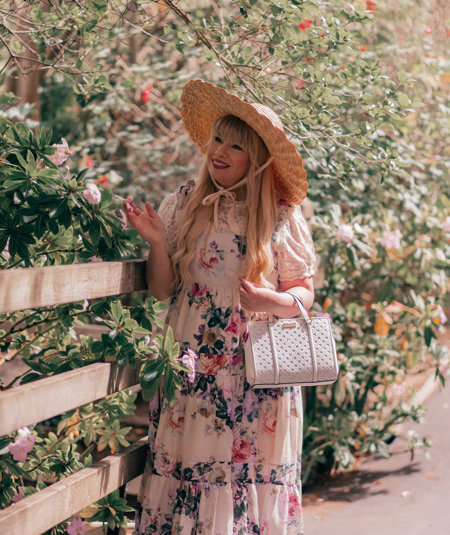 Feminine Fashion Blogger Elizabeth Hugen of Lizzie in Lace shares How to Create a Cottagecore Aesthetic Outfit featuring a floral chicwish dress and white kate spade bag