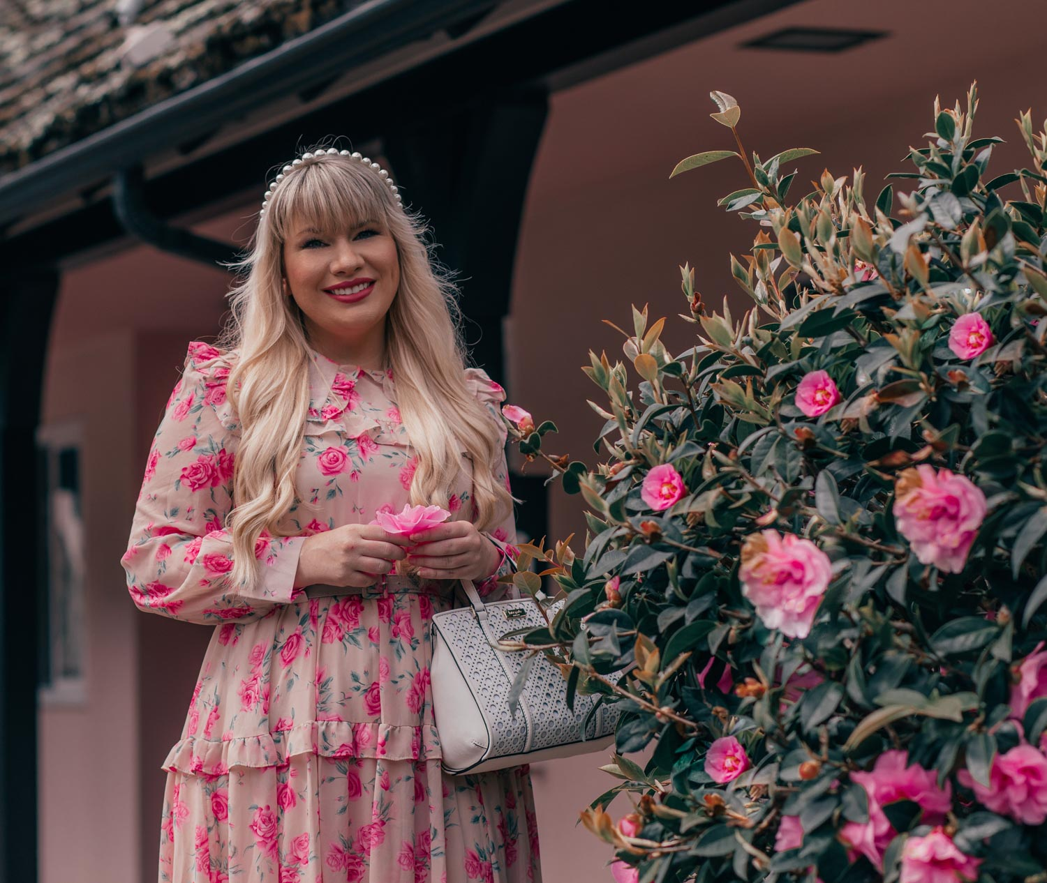 Feminine Fashion Blogger Elizabeth Hugen of Lizzie in Lace shares how to wear the statement collar trend along with a summer outfit including a pink floral chicwish dress and a white kate spade handbag