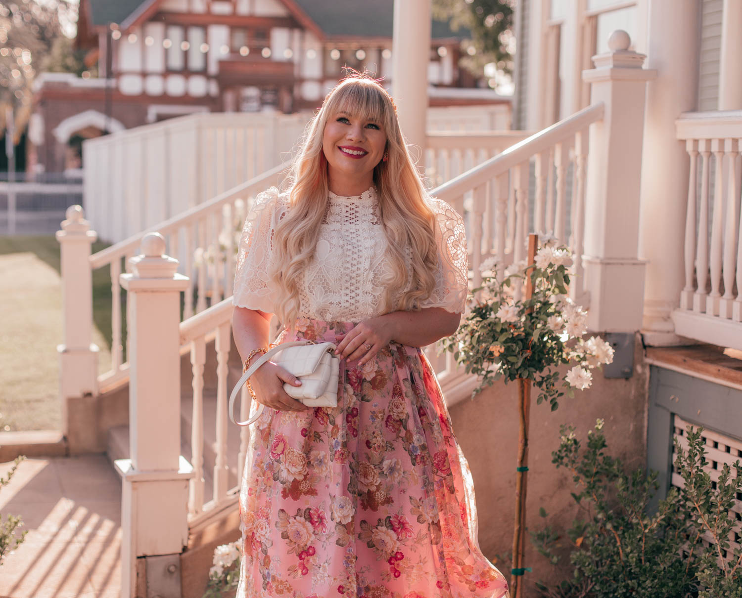 Feminine Fashion Blogger Elizabeth Hugen of Lizzie in Lace shares a feminine floral summer outfit idea including a white lace top and pink floral chicwish skirt