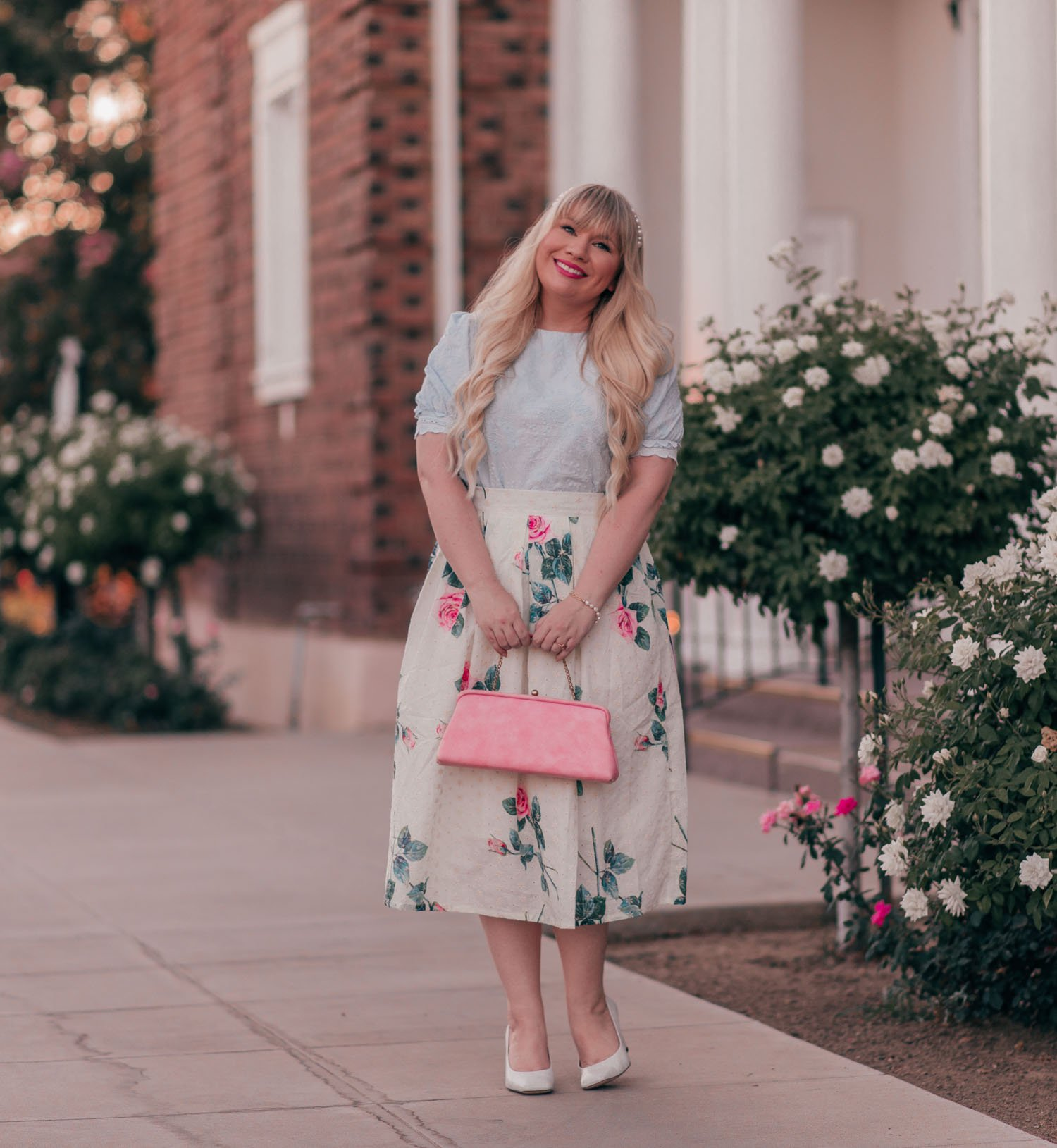 Feminine fashion blogger Elizabeth Hugen of Lizzie in Lace shares a pretty pastel vintage inspired floral skirt outfit along with a summer Chicwish haul