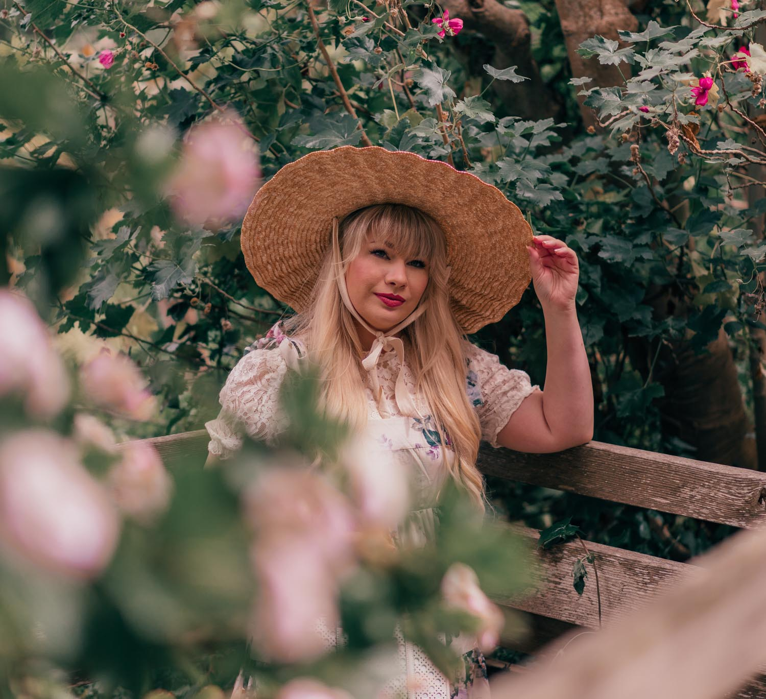 Feminine Fashion Blogger Elizabeth Hugen of Lizzie in Lace shares How to Create a Cottagecore Aesthetic Outfit featuring a floral chicwish dress and lack of color hat