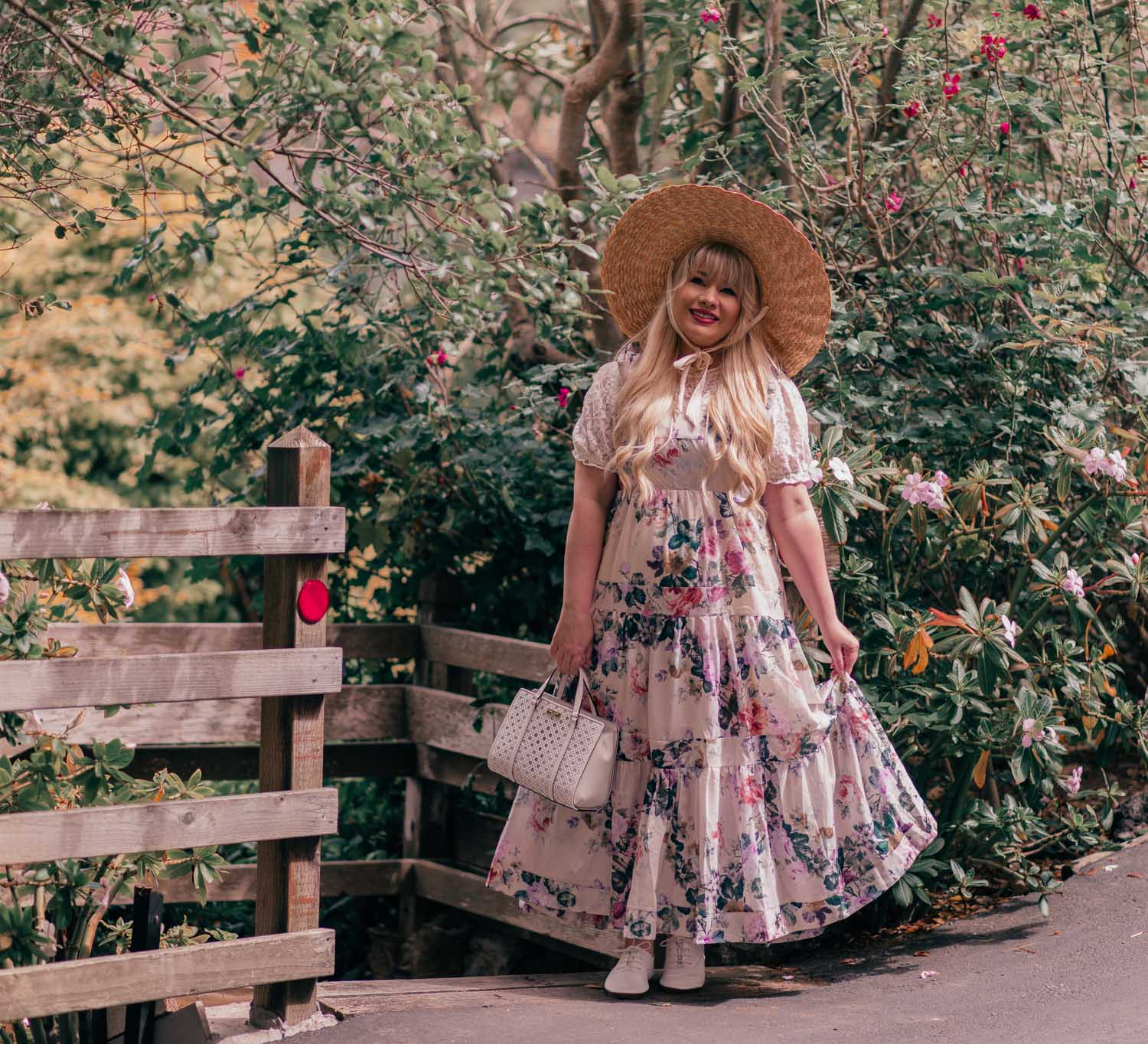 Feminine Fashion Blogger Elizabeth Hugen of Lizzie in Lace shares How to Create a Cottagecore Aesthetic Outfit featuring a floral chicwish maxi dress and lack of color hat