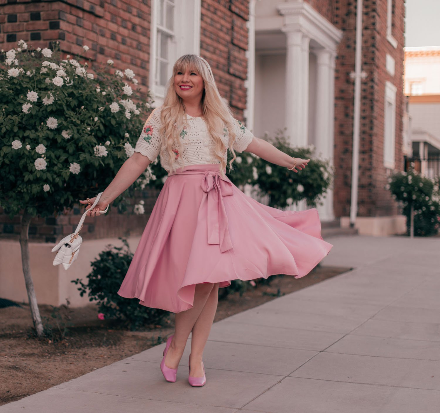 Feminine fashion blogger Elizabeth Hugen of Lizzie in lace shares How to Wear a Vintage Inspired Cardigan for Summer including a pink chicwish skirt