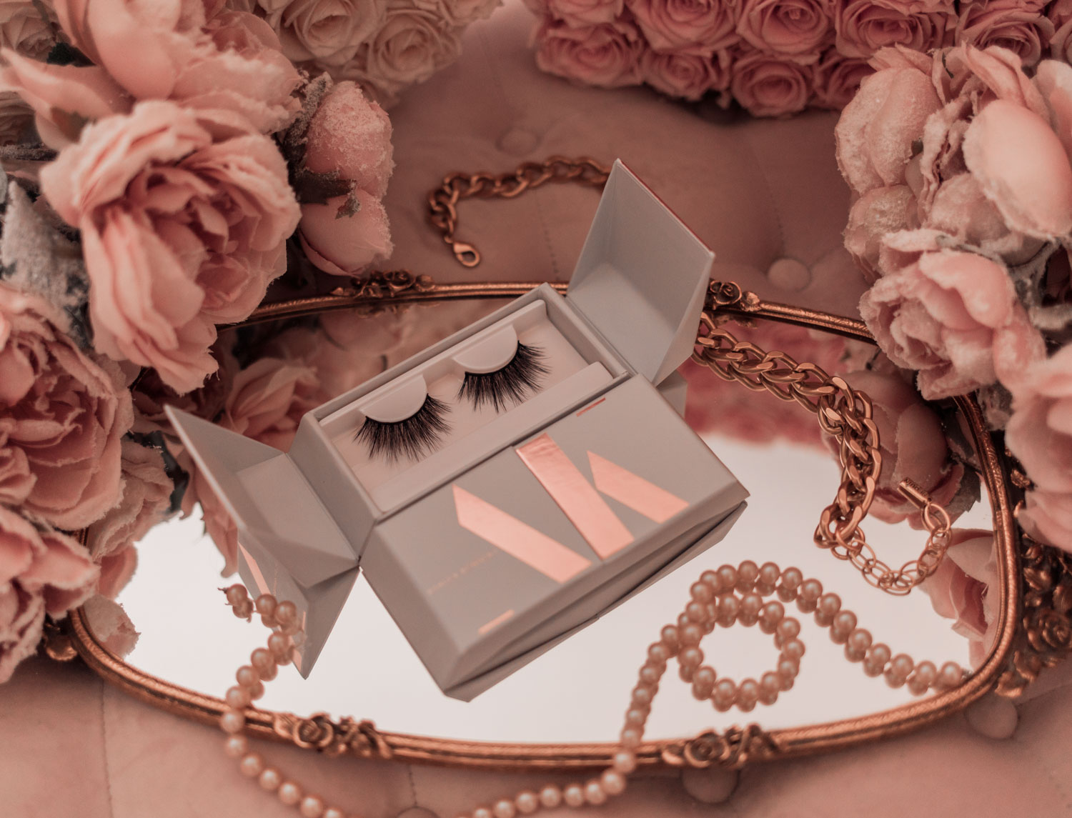 Feminine fashion and beauty blogger Elizabeth Hugen of Lizzie in Lace shares her honest Ashley Kennedy lashes review and comparison of all the false eyelashes and the adhesive pens