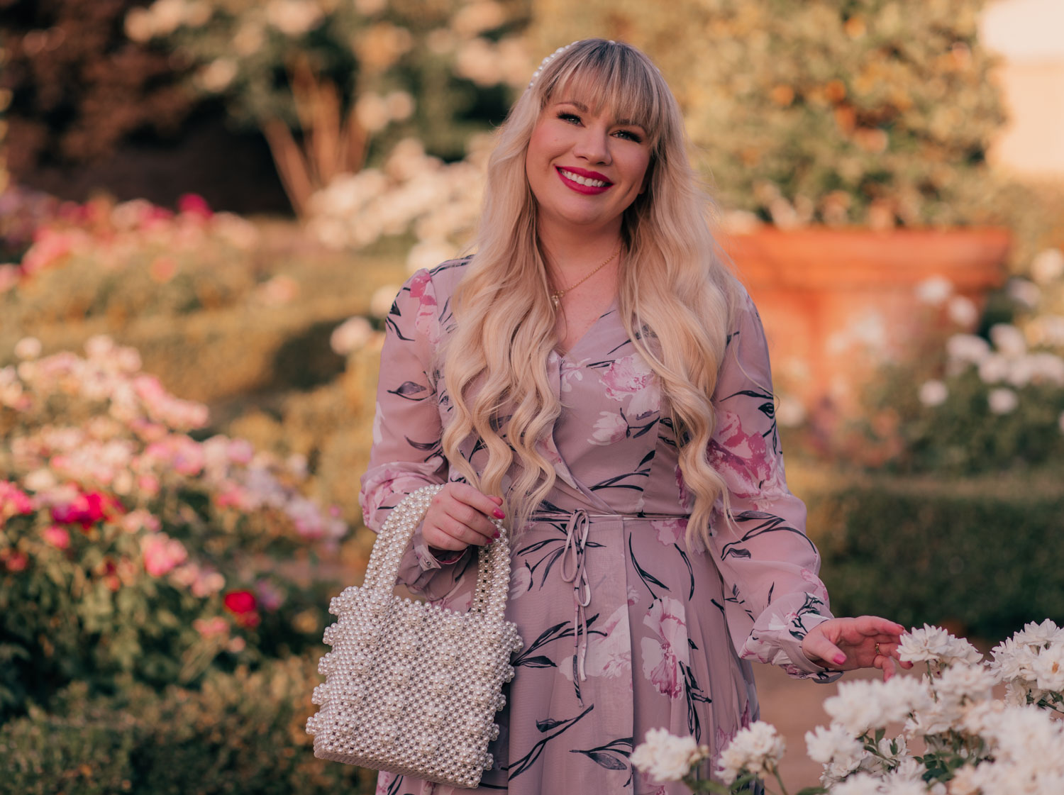 Feminine fashion blogger Elizabeth Hugen of Lizzie in Lace shares A Flattering Maxi Dress for Every Body Type including this floral Chicwish maxi dress and a pearl handbag
