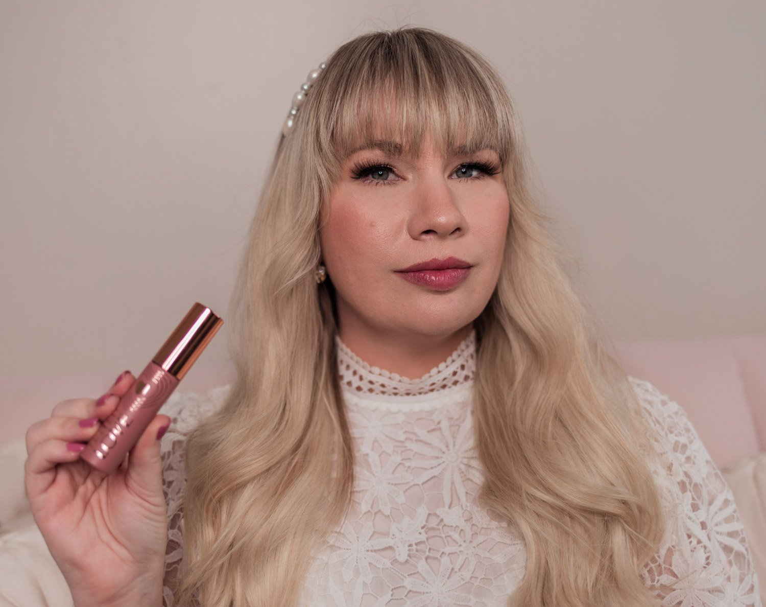 Feminine fashion and beauty blogger Elizabeth Hugen of Lizzie in Lace shares the Charlotte Tilbury Look of Love Collection Review and lipstick swatches including the Tinted Love Blushed Rose lip and cheek tint