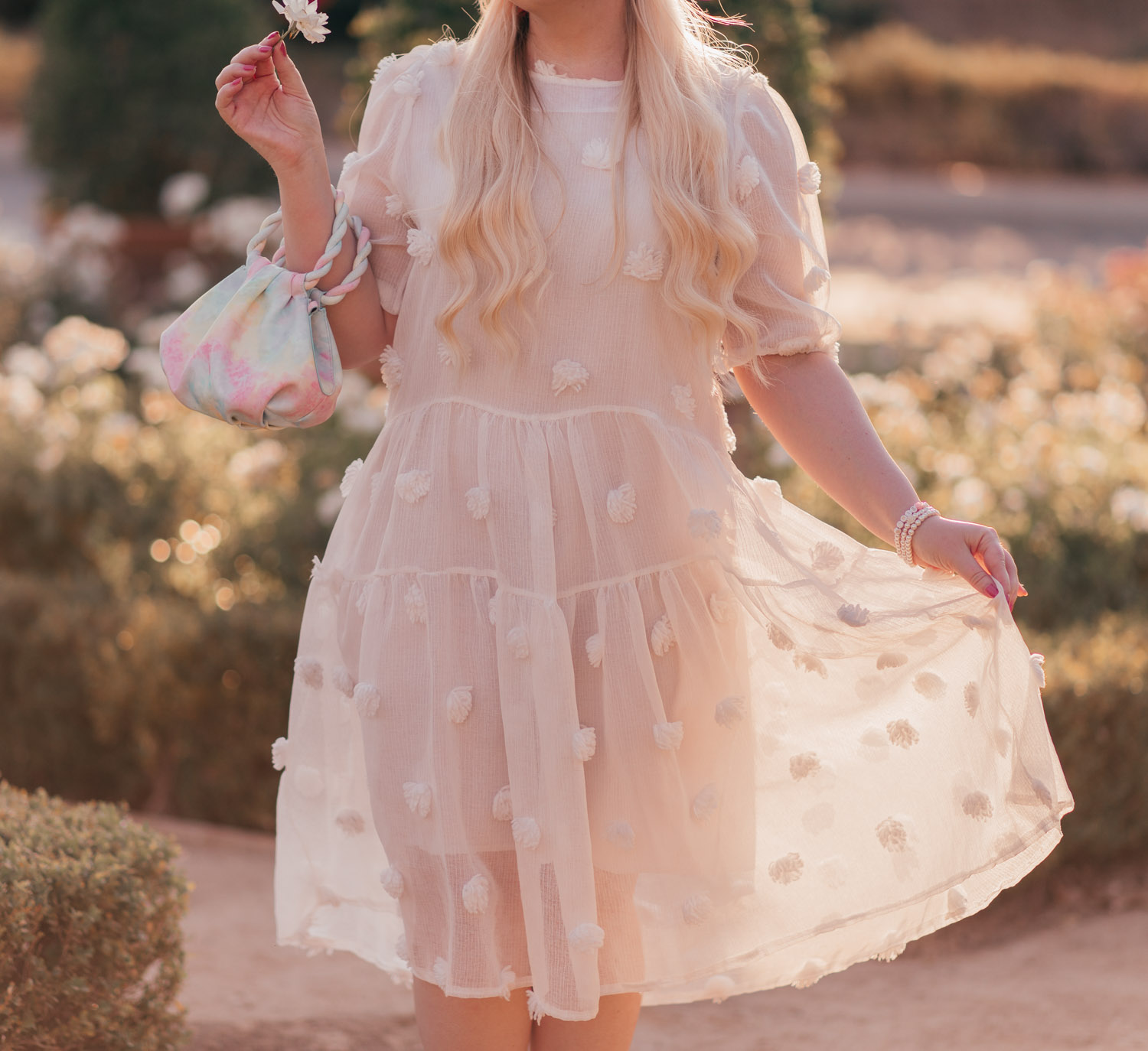 Feminine fashion blogger Elizabeth Hugen of Lizzie in Lace shares a Girly Summer Outfit Idea with a white summer dress and rainbow handbag