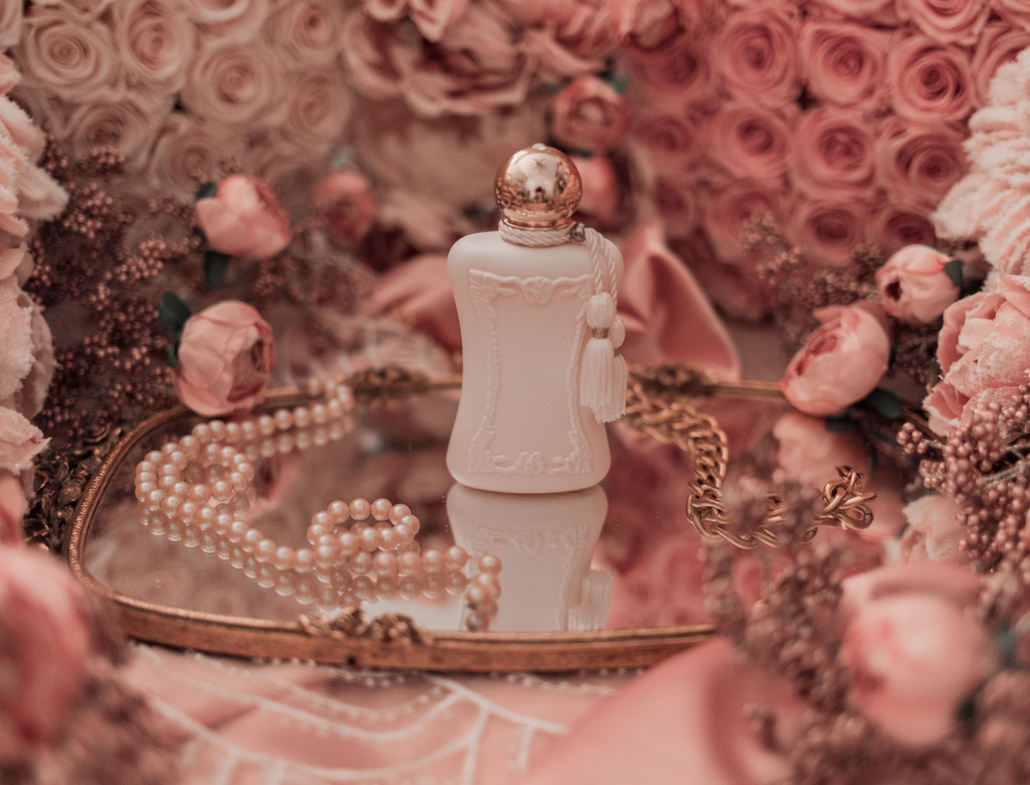 Feminine fashion and beauty blogger Elizabeth Hugen of Lizzie in Lace shares the Parfums de Marly feminine perfume collection including Sedbury