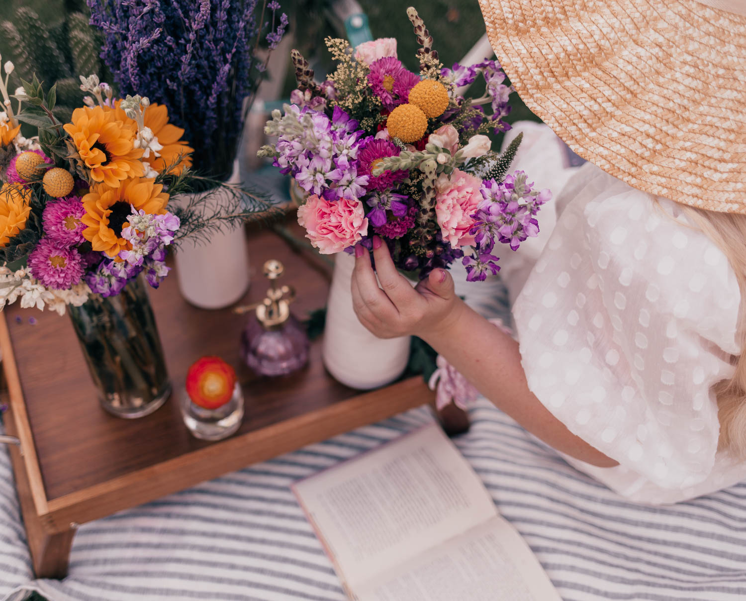 Feminine Fashion Blogger Elizabeth Hugen of Lizzie in Lace shares her June 2021 Month in Review and her feminine picnic outfit including a white puff sleeve dress and Urban stems flower bouquets