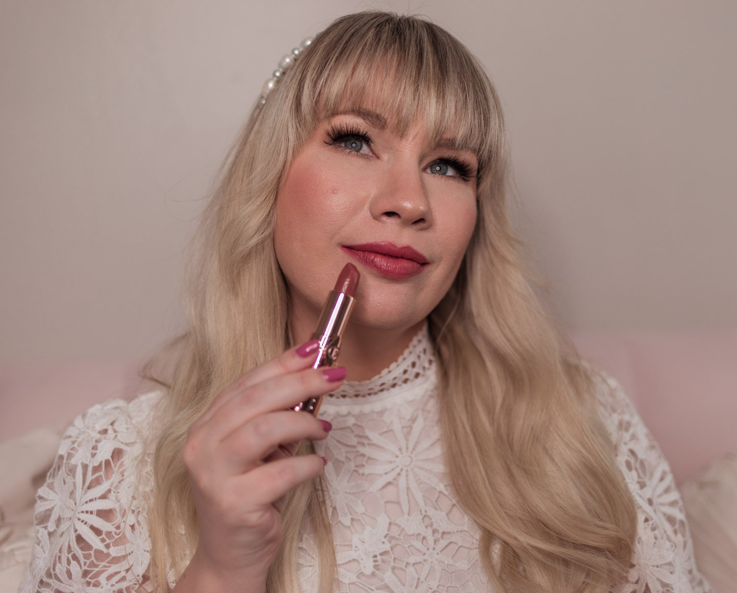 Feminine fashion and beauty blogger Elizabeth Hugen of Lizzie in Lace shares the Charlotte Tilbury Look of Love Collection Review and lipstick swatches including her Nude Romance lipstick review - the perfect wedding lipstick!