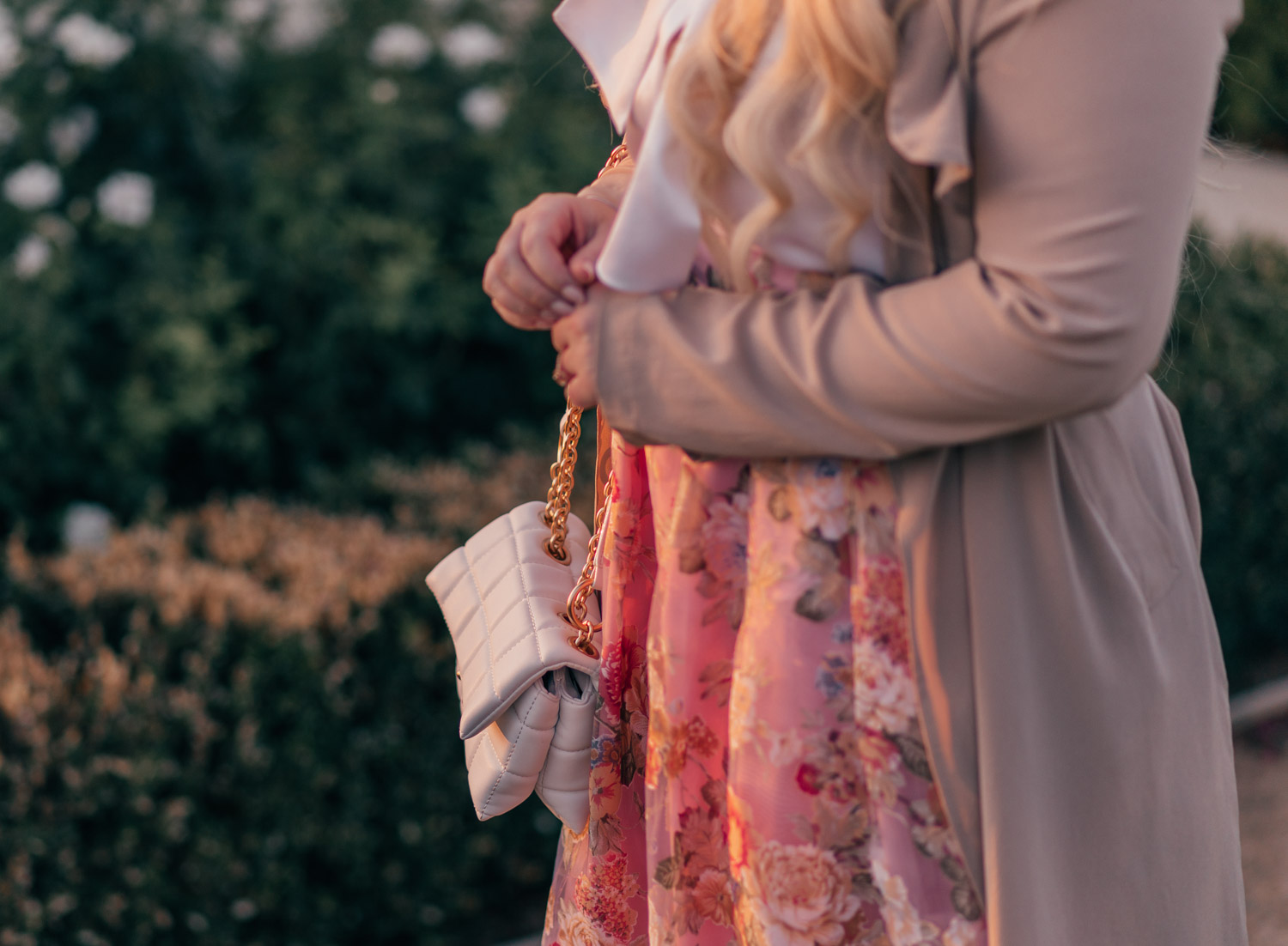 Feminine fashion blogger Elizabeth Hugen of Lizzie in Lace shares How to Style a Classically Feminine Outfit including a floral Chicwish skirt and House of Want handbag