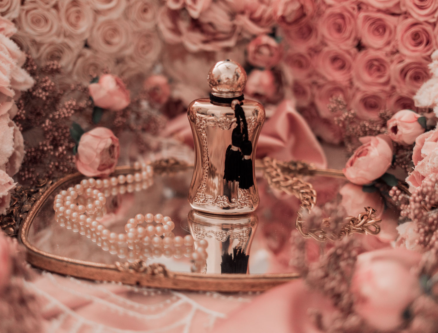 Feminine fashion and beauty blogger Elizabeth Hugen of Lizzie in Lace shares the Parfums de Marly feminine perfume collection including Darcy
