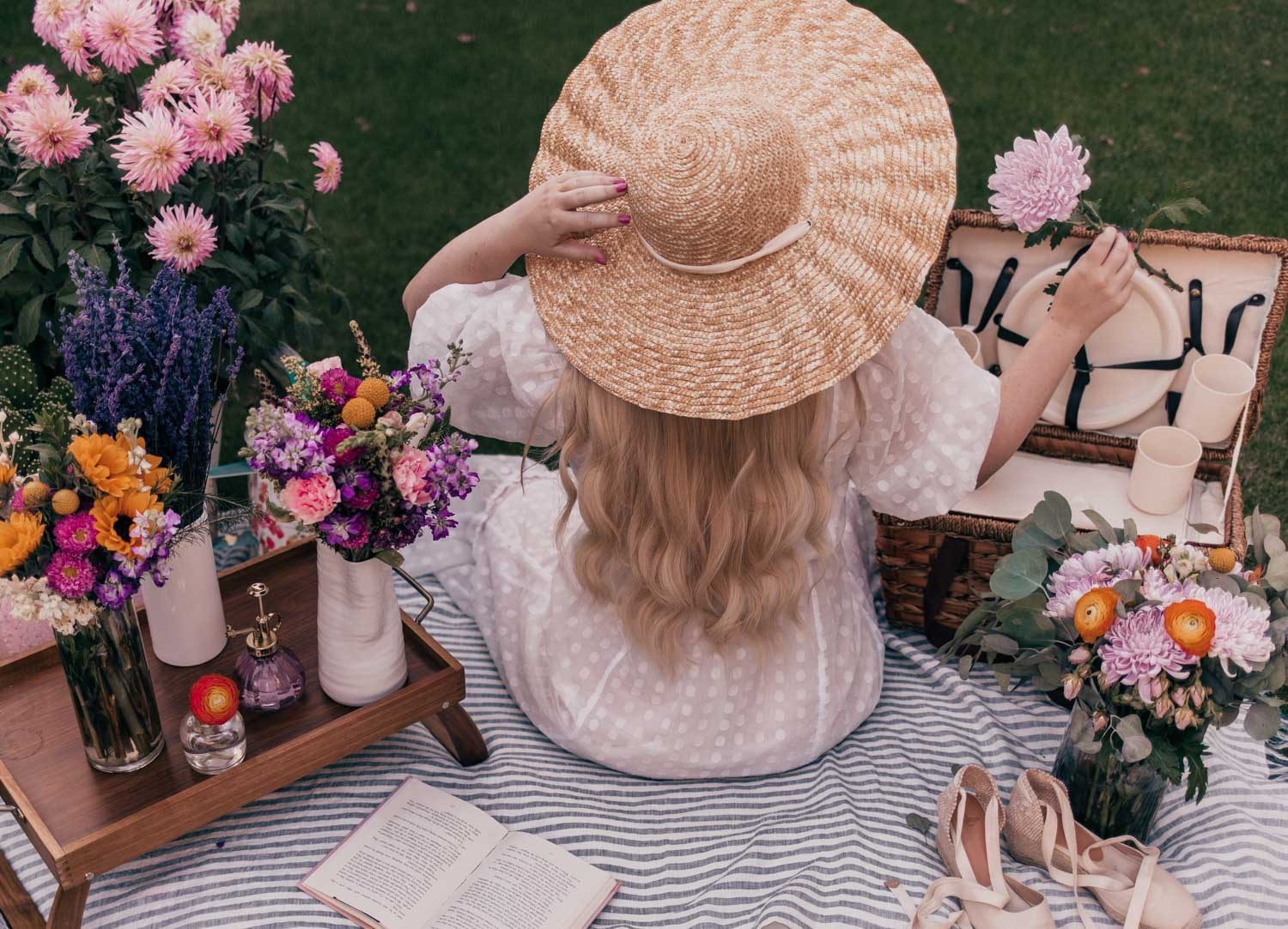 Feminine Fashion Blogger Elizabeth Hugen of Lizzie in Lace shares her June 2021 Month in Review and her feminine picnic outfit including a white puff sleeve dress and Lack of Color Scalloped Hat