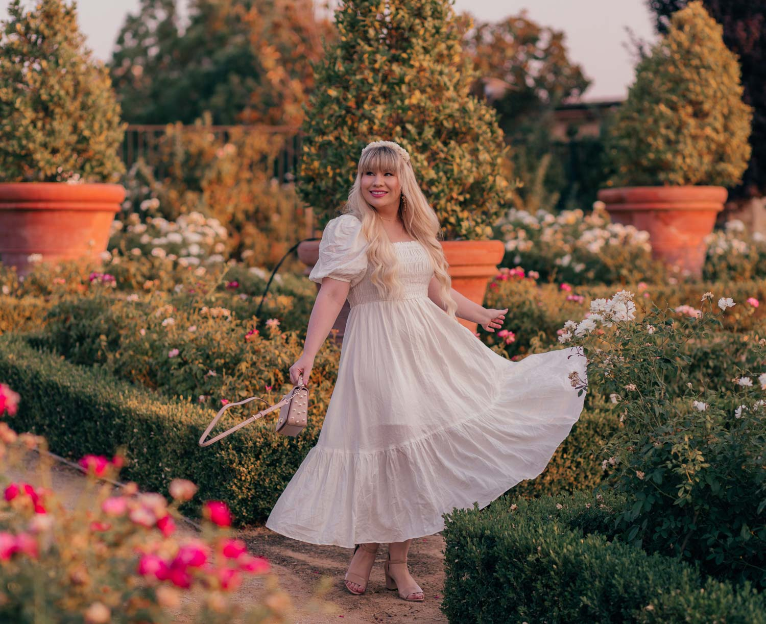 Feminine Fashion Blogger Elizabeth Hugen of Lizzie in Lace shares a cottagecore outfit idea including this white puff sleeve dress from Chicwish