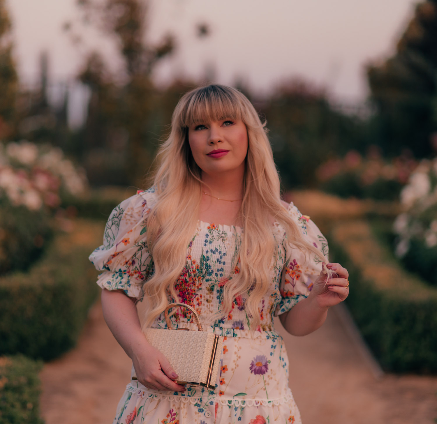 Feminine Fashion Blogger Elizabeth Hugen of Lizzie in Lace styles a floral top and skirt set from Chicwish for summer