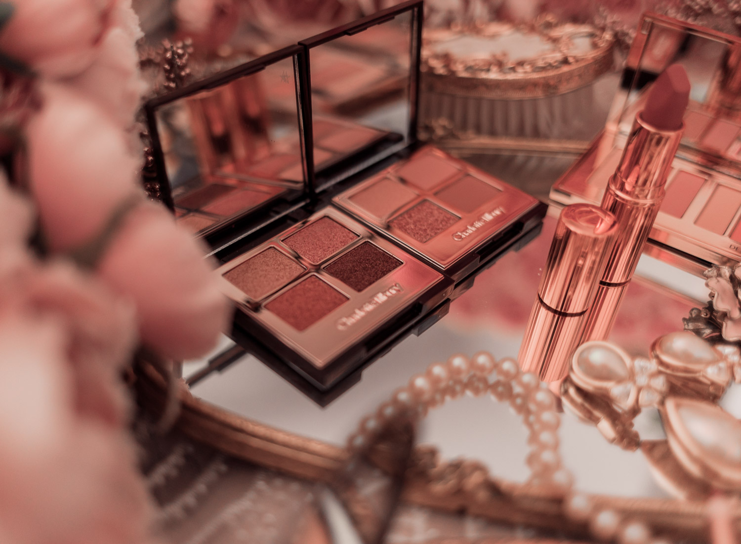 Feminine fashion and beauty blogger Elizabeth Hugen of Lizzie in Lace shares her honest Charlotte Tilbury Pillowtalk Collection Review including the pillowtalk luxury eyeshadow palette