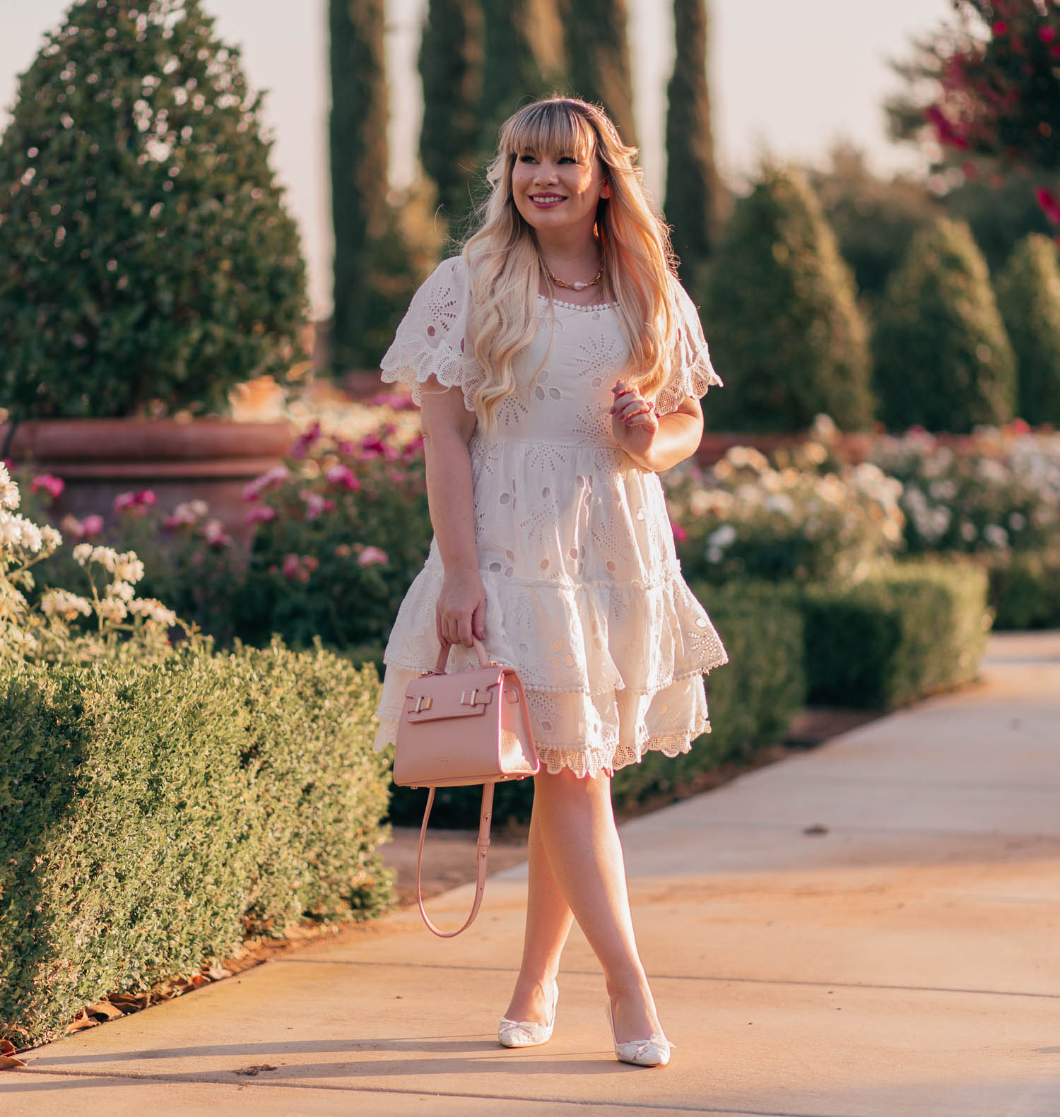 Feminine Fashion Blogger Elizabeth Hugen of Lizzie in Lace shares the perfect white summer dress for the girly girl