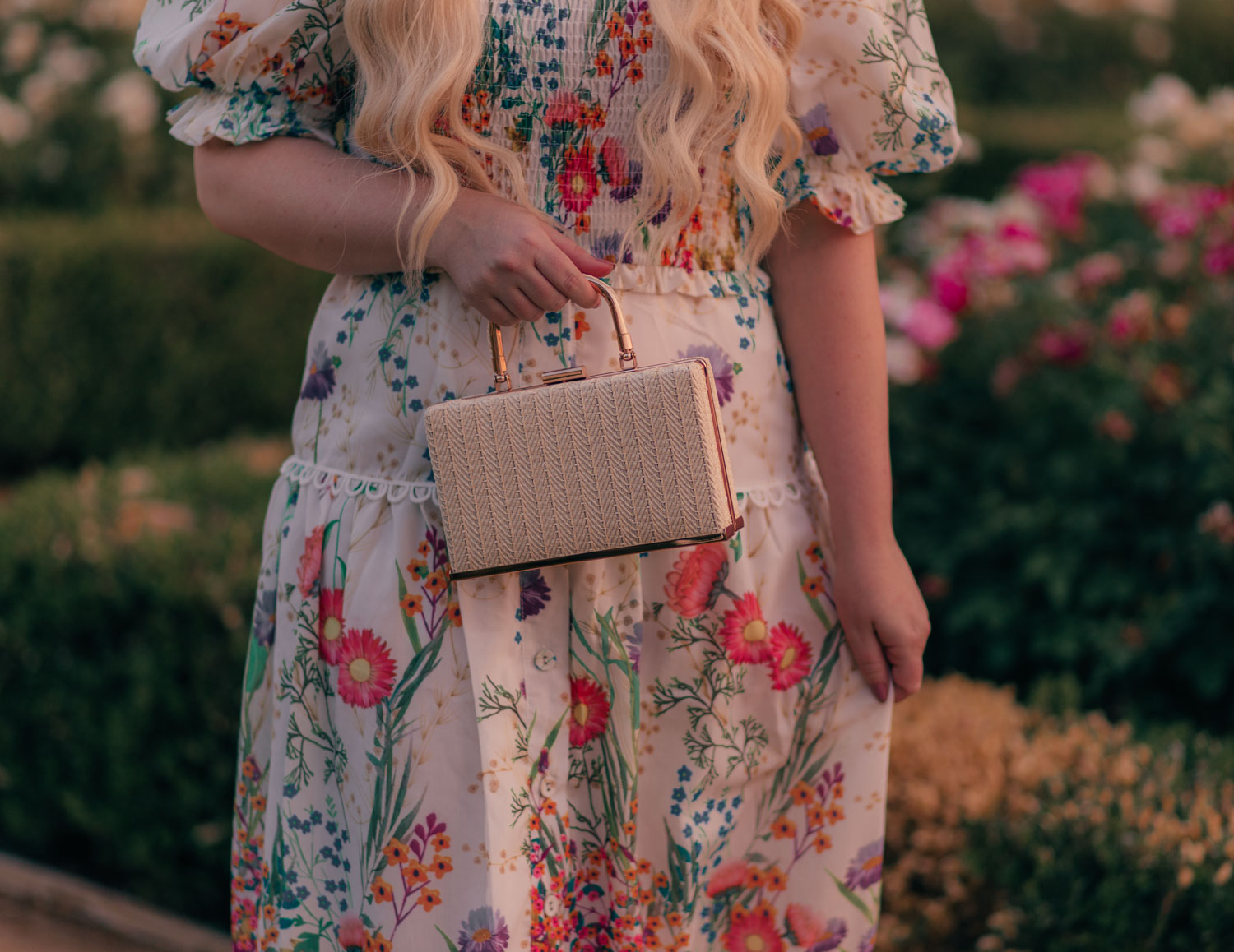 Feminine Fashion Blogger Elizabeth Hugen of Lizzie in Lace styles a floral top and skirt set from Chicwish for summer along with a vintage inspired handbag