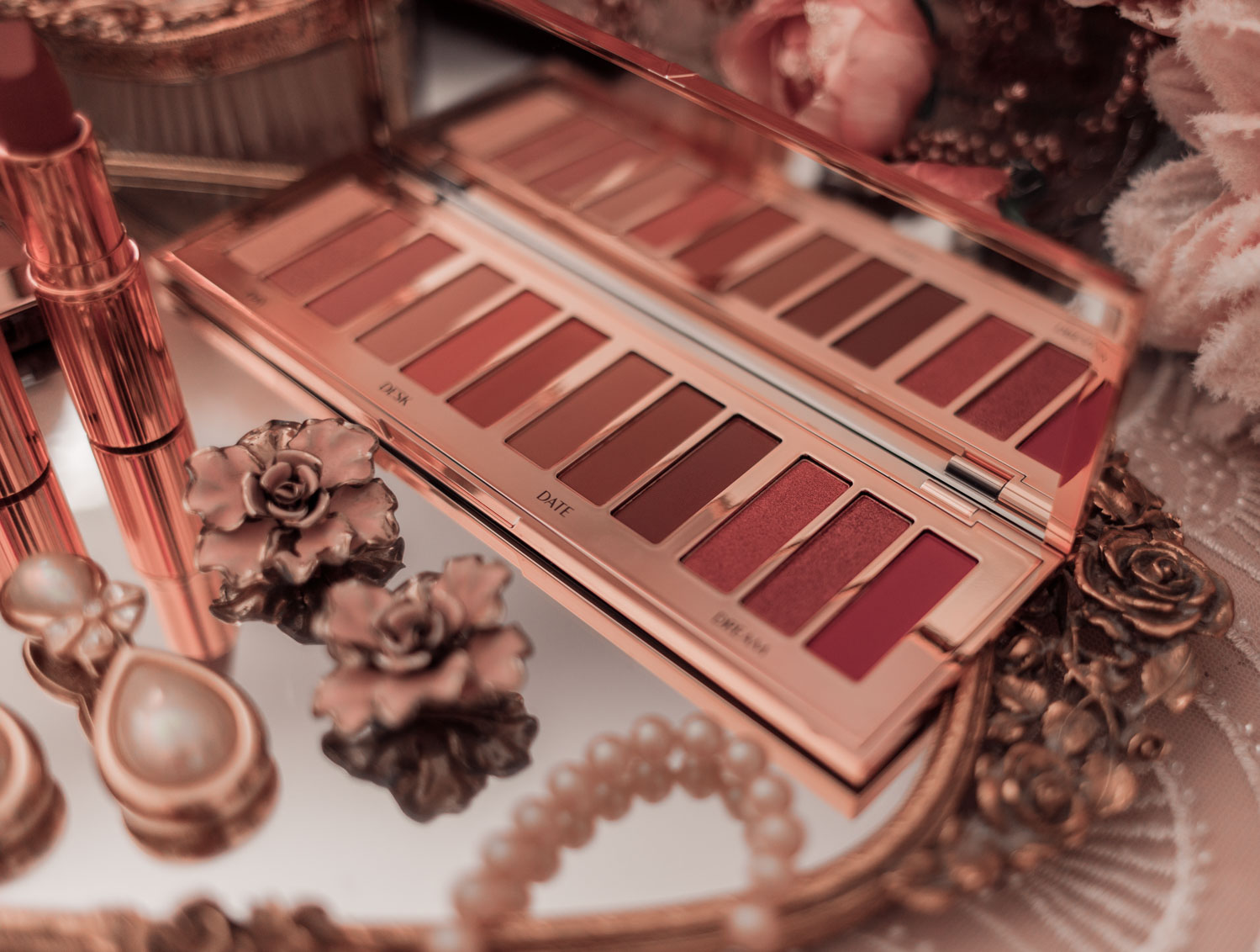 Feminine fashion and beauty blogger Elizabeth Hugen of Lizzie in Lace shares her honest Charlotte Tilbury Pillowtalk Collection Review including the pillowtalk instant eyeshadow palette