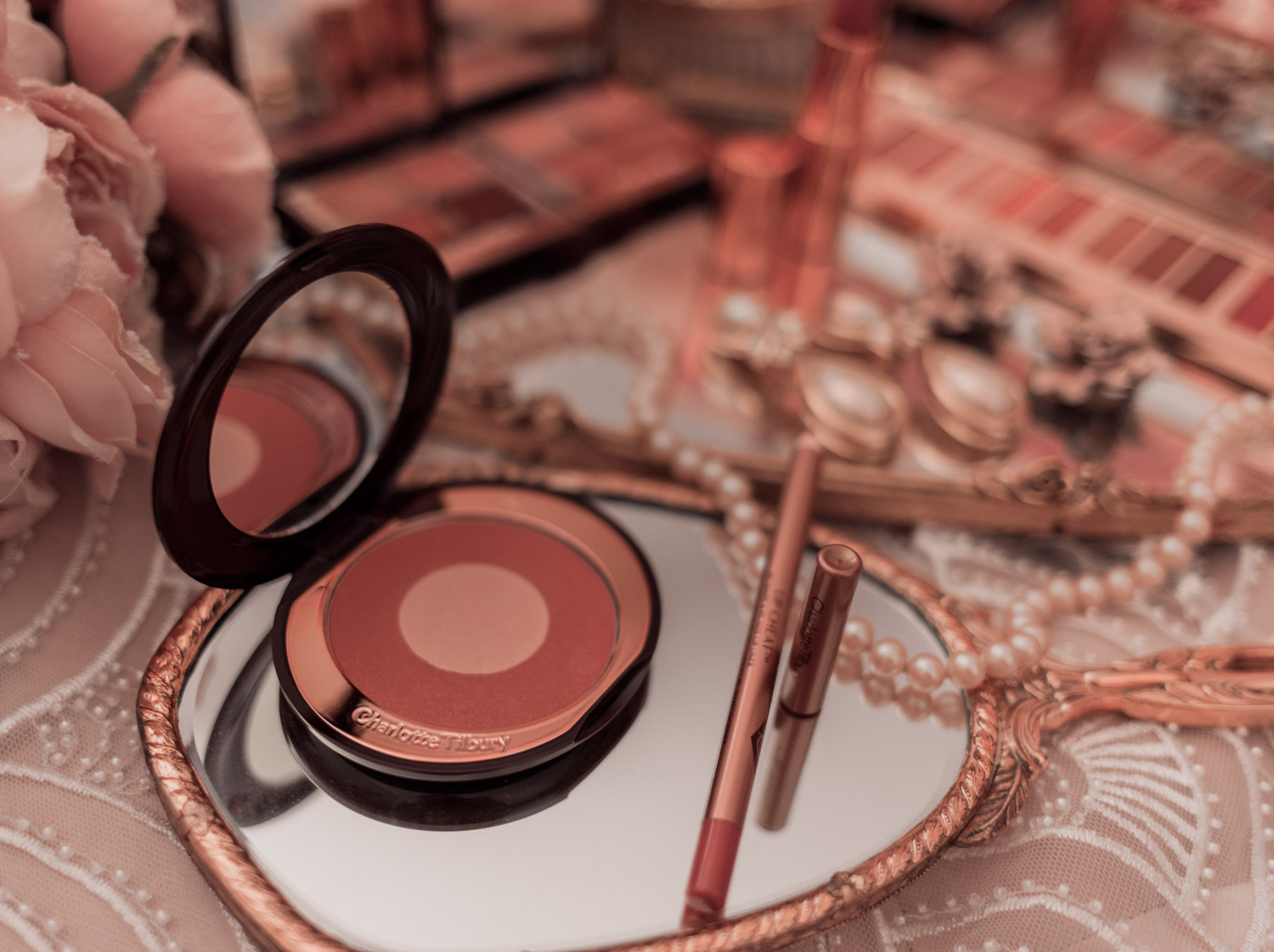 Feminine fashion and beauty blogger Elizabeth Hugen of Lizzie in Lace shares her honest Charlotte Tilbury Pillowtalk Collection Review including the pillowtalk blush and lip cheat