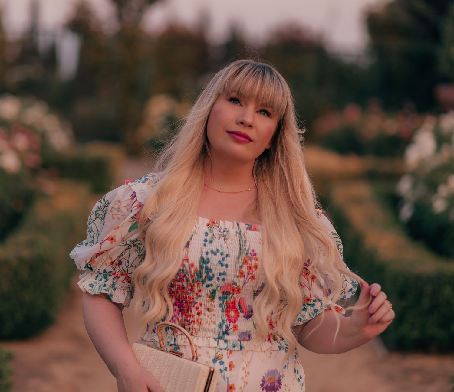 Feminine Fashion Blogger Elizabeth Hugen of Lizzie in Lace styles a floral top and skirt set from Chicwish for summer along with a dainty gold necklace