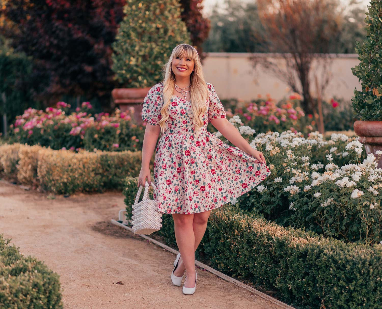 Feminine Fashion Blogger Elizabeth Hugen of Lizzie in Lace shares her July 2021 Month in Review along with a red rose print dress from Chicwish