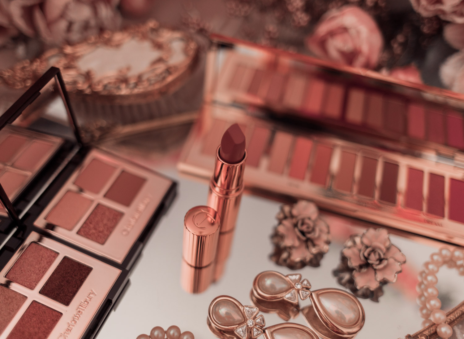 Feminine fashion and beauty blogger Elizabeth Hugen of Lizzie in Lace shares her honest Charlotte Tilbury Pillowtalk Collection Review including the pillowtalk lipstick