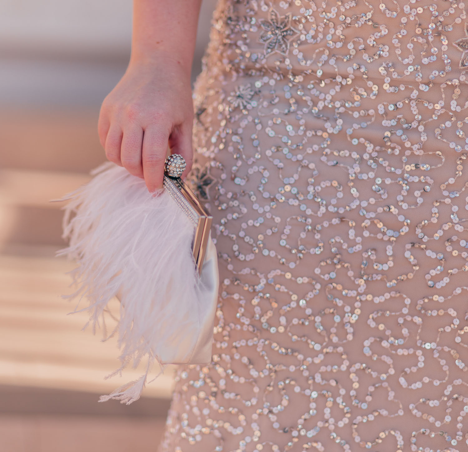 Feminine Fashion Blogger Elizabeth Hugen of Lizzie in Lace shares her Old Hollywood Glam Outfit Inspo with a glamorous Adrianna Papell sequin dress and a Nina Shoes white feather clutch