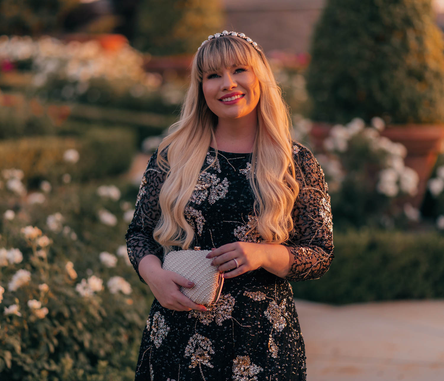 Feminine Fashion Blogger Elizabeth Hugen of Lizzie in Lace style a gorgeous formal dress - a black floral sequin dress from Adrianna Papell - the perfect holiday party dress, wedding guest dress or special occasion dress