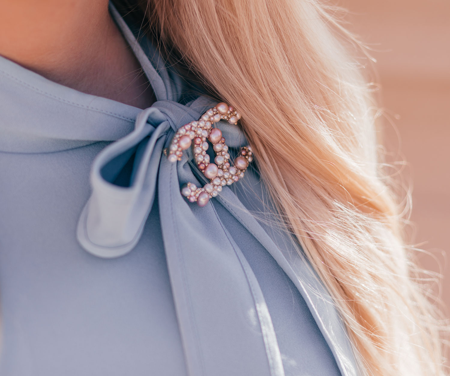 Feminine Fashion Blogger Elizabeth Hugen of Lizzie in Lace Styles The Cutest Feminine Vintage Inspired Outfit including an Adrianna Papell bow neck dress with a pink pearl Chanel brooch