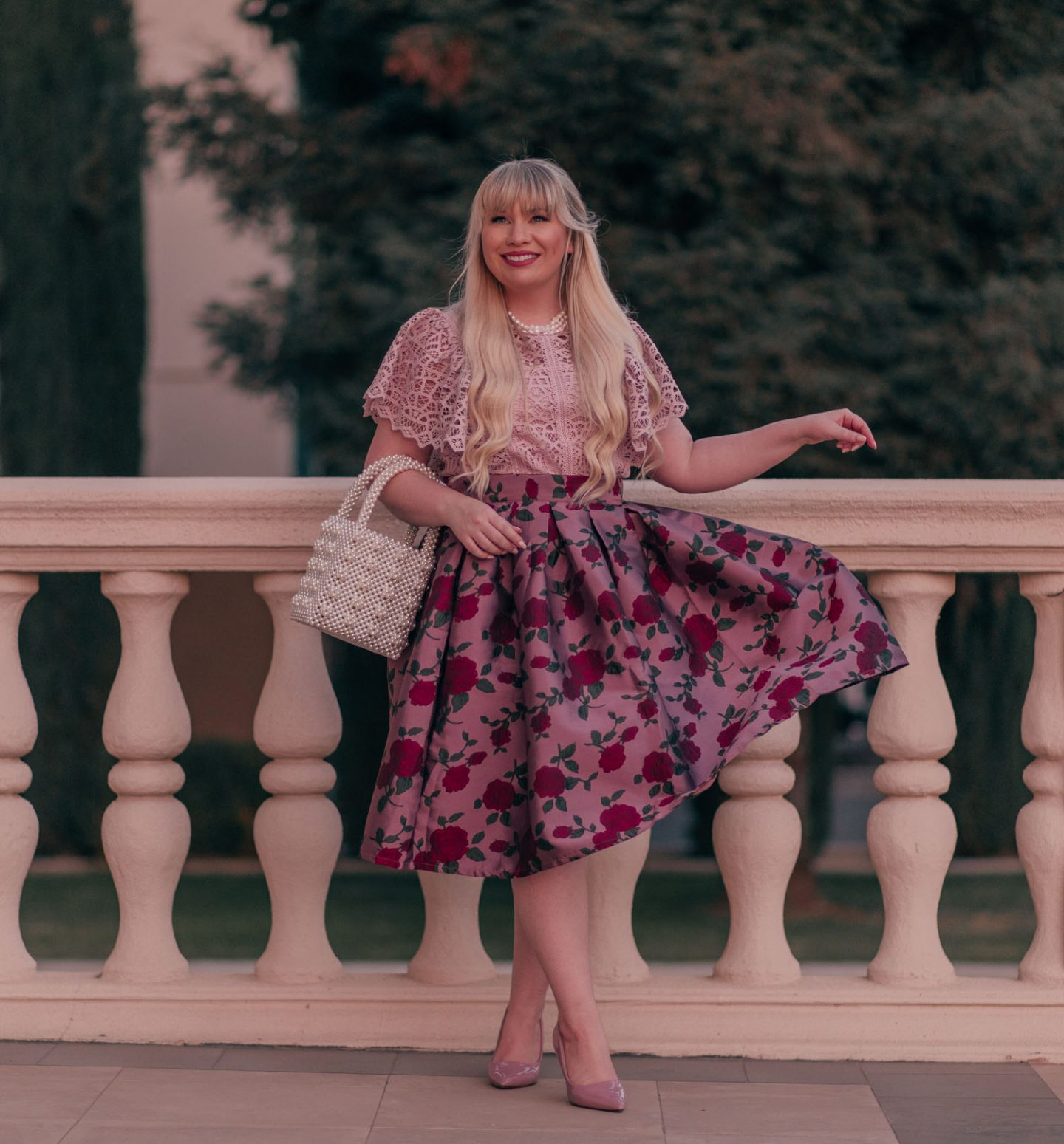 Feminine Fashion Blogger Elizabeth Hugen of Lizzie in Lace shares 5 Easy Ways to Dress More Feminine and wear a pink outfit with a lace top and floral skirt