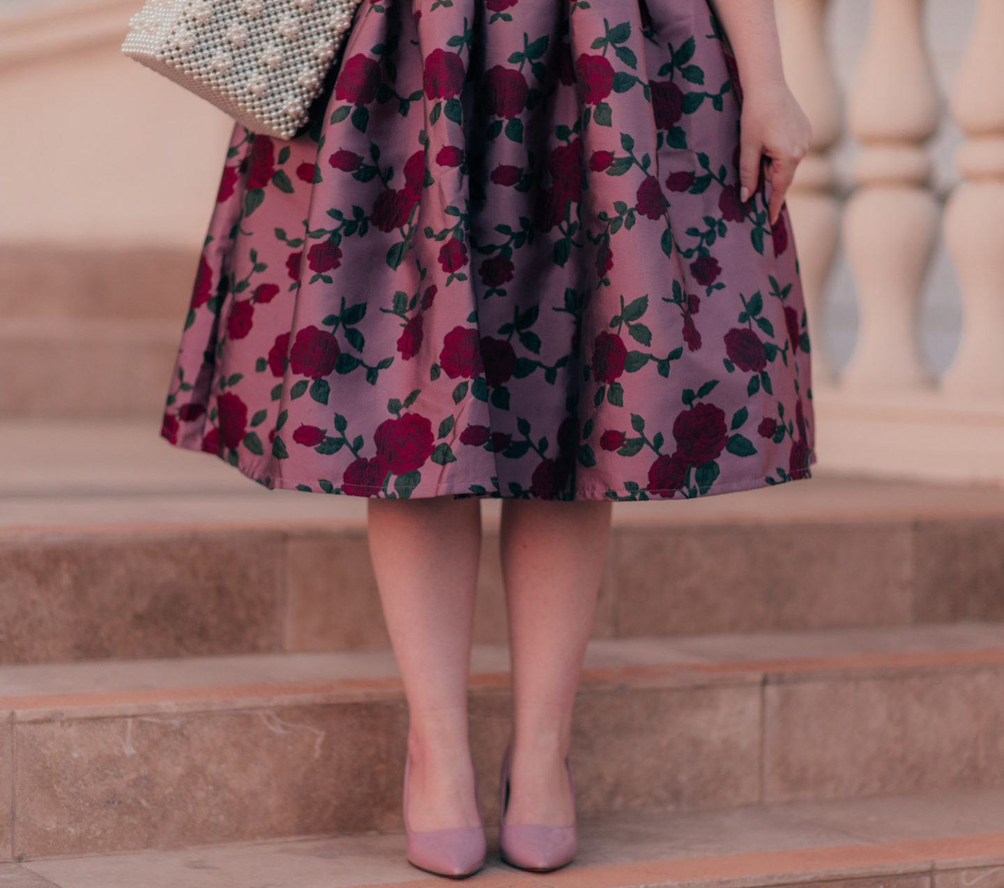 Feminine Fashion Blogger Elizabeth Hugen of Lizzie in Lace shares 5 Easy Ways to Dress More Feminine and wear a pink outfit with floral skirt