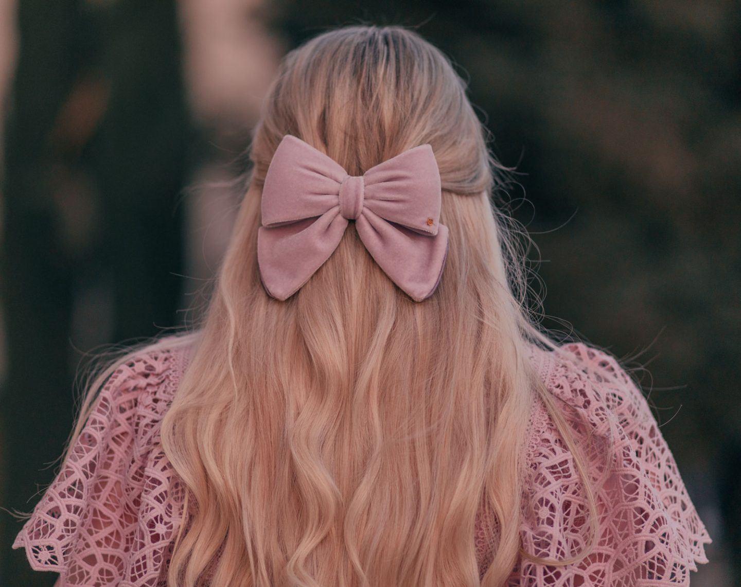 Feminine Fashion Blogger Elizabeth Hugen of Lizzie in Lace shares 5 Easy Ways to Dress More Feminine and wear a pink outfit with a lace top and velvet hair bow